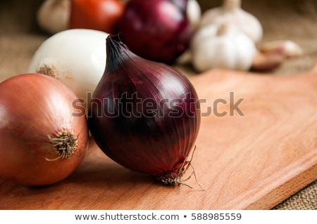Fresh red and white onions on a wooden background Stock photo © Virgin