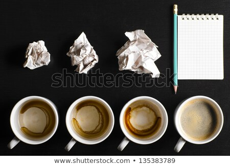 still life of paper and a crumpled paper on a table with a pen Stock photo © mizar_21984