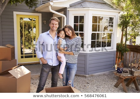 family standing outside new home stock photo © is2