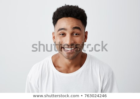 close up portrait of a man in a white shirt stock photo © deandrobot