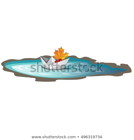 Paper boat with a fallen maple leaf floats in a puddle. Symbols of autumn isolated on white backgrou Stock photo © Lady-Luck