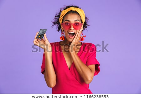Portrait of an excited young african woman in headband Stock photo © deandrobot