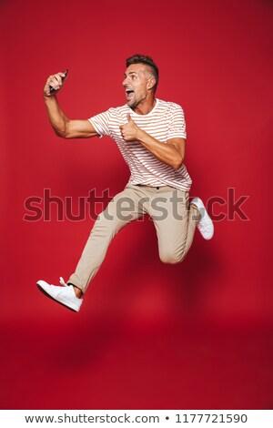 Tam uzunlukta fotoğraf kafkas adam çizgili tshirt Stok fotoğraf © deandrobot