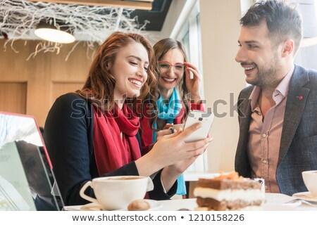 Tre giovani amici cellulare divertimento pausa caffè Foto d'archivio © Kzenon