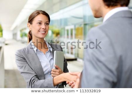 feliz · mujer · de · negocios · apretón · de · manos · socio · reunión - foto stock © massonforstock