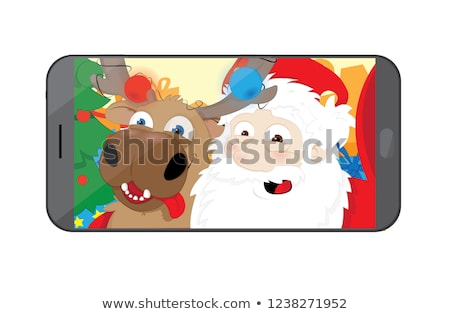 Funny Santa Claus and Reindeer taking a selfie in their workshop stock photo © pcanzo