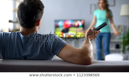 wife unhappy that husband is watching football stock photo © elnur