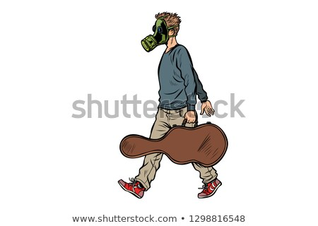 passer by guitarist in gas mask bad ecology dirty air stock photo © studiostoks