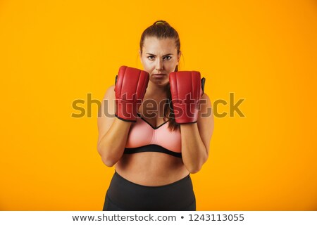 Portrait of sporty chubby woman in tracksuit wearing boxing glov Stock photo © deandrobot