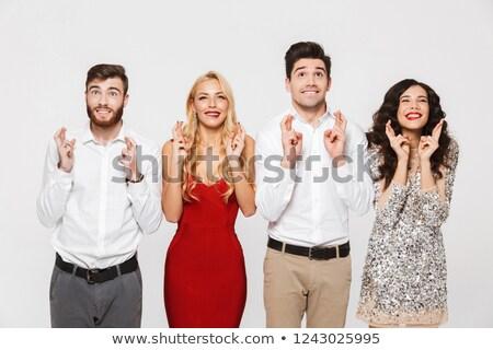Excité jeunes groupe amis permanent isolé Photo stock © deandrobot