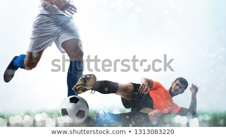 Close up of a football action scene with competing soccer players on white background Stock photo © alphaspirit