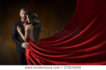Maakt een reservekopie elegante paar poseren studio man Stockfoto © feedough