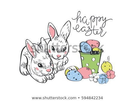 Happy Easter. Rabbit hare bunny and eggs. Hanging painted eggs.Greeting card.Wicker basket with eggs stock photo © bonnie_cocos