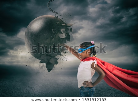 Power and determination of a child against a wrecking ball Stock photo © alphaspirit