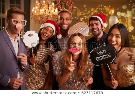 Stock photo: happy couple with party props having fun