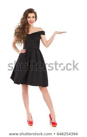 Gyönyörű lány vörös haj fekete ruha piros sarkak teljes alakos Stock fotó © studiolucky
