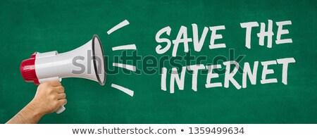 A man holding a megaphone - Save the internet Stock photo © Zerbor