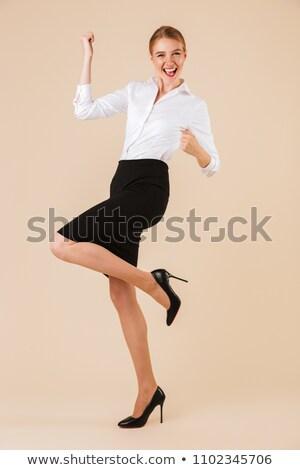 возбужденный деловой женщины позируют изолированный белый стены Сток-фото © deandrobot