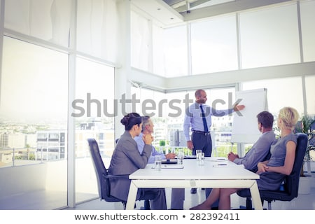 businessman giving presentation to his colleagues stock photo © andreypopov
