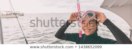 Snorkel mask Asian woman tourist getting ready for snorkeling activity tour from boat banner panoram Stock photo © Maridav