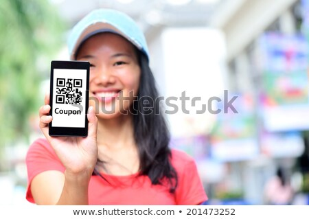 Woman Holding Cellphone With Shopping Coupon Stock photo © AndreyPopov