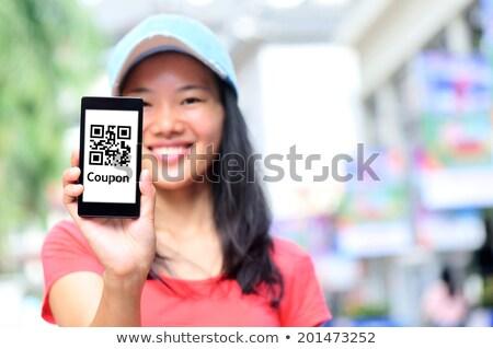 Nő tart mobiltelefon vásárlás utalvány közelkép Stock fotó © AndreyPopov