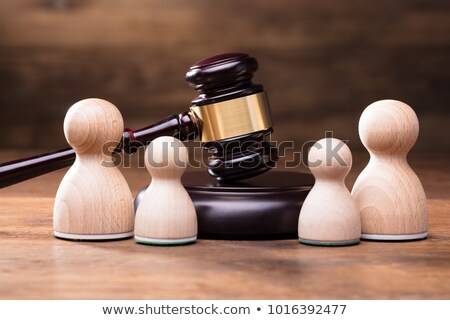 Separation Of Wooden Pawn Figures With Gavel Stock photo © AndreyPopov