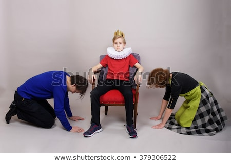 mother Parent down before their son are king Stock photo © Lopolo