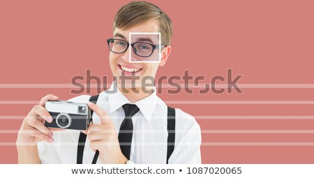 man with eye focus box detail over glasses holding camera and lines Stock photo © wavebreak_media