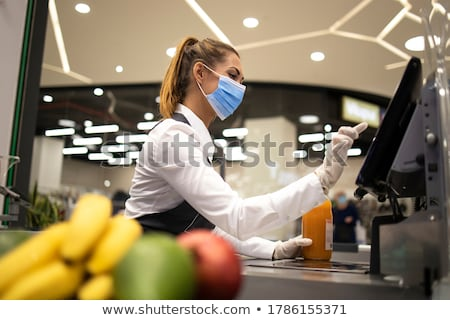 Cashier in supermarket at workplace Stock photo © jossdiim