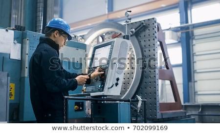 Laborer at milling machine. Stock photo © lichtmeister