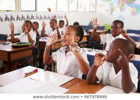 Side view of school kids raising hand in classroom Stock photo © wavebreak_media
