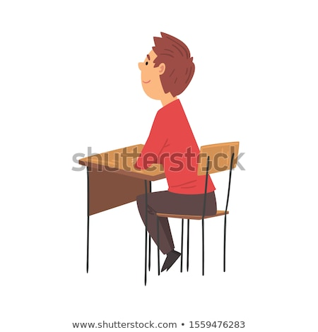 Side view of schoolkids studying and sitting at desk in classroom of elementary school Stock photo © wavebreak_media