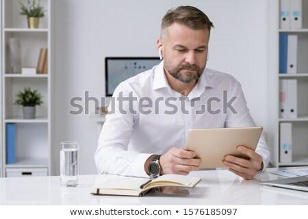 Sérieux affaires regarder touchpad écran regarder Photo stock © pressmaster