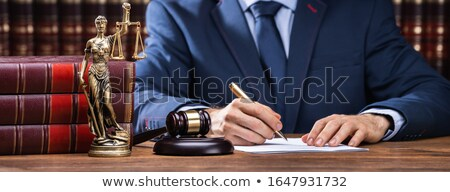 Lawyer Signing Documents Near Mallet And Scales Stock photo © AndreyPopov