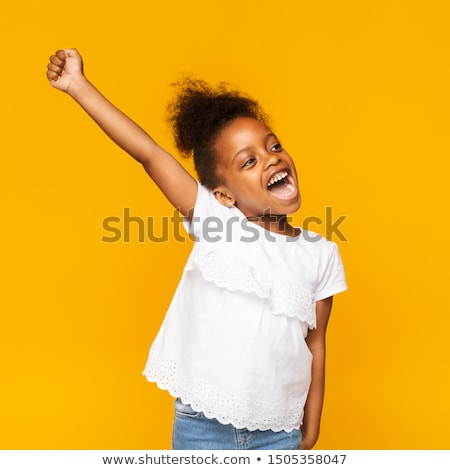 happy little african american girl with hands up stock photo © dolgachov