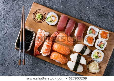 Asian food sushi on board with wooden chopsticks Stock photo © jossdiim