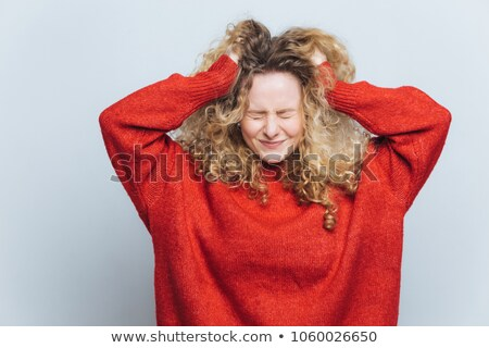 Stressful frustrated blonde woman tears out hair, regrets wrong doing, expresses negative emotions,  Stock photo © vkstudio