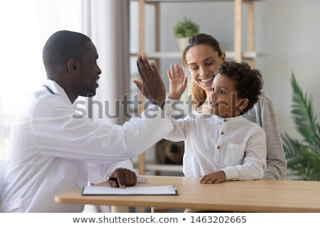 Checking health in clinic, therapist or physician consultation, patient talking with doctor Stock photo © robuart