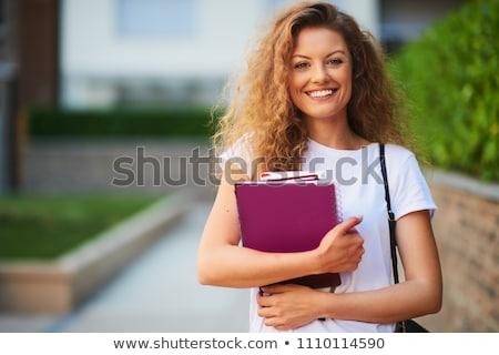 Gelukkig schoolmeisje boeken student geïsoleerd Stockfoto © Anna_Om
