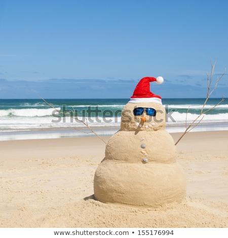 Hóember ki homok mikulás kalap tengerpart Stock fotó © KonArt