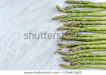 green asparagus on marble table stock photo © sandralise