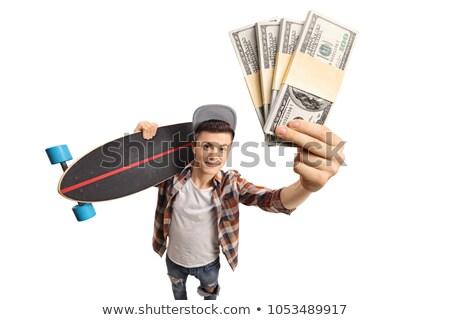 Happy teen boy holding money Stock photo © lovleah