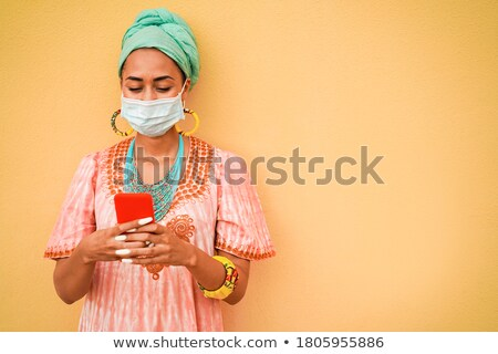 Stock photo: Portrait of an Afro woman on phone