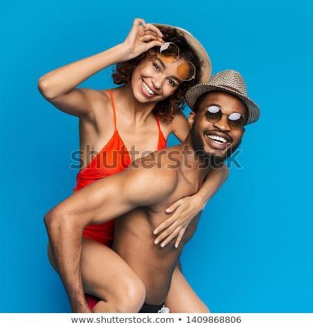 vriendje · op · de · rug · vriendin · strand · man · gelukkig - stockfoto © hasloo