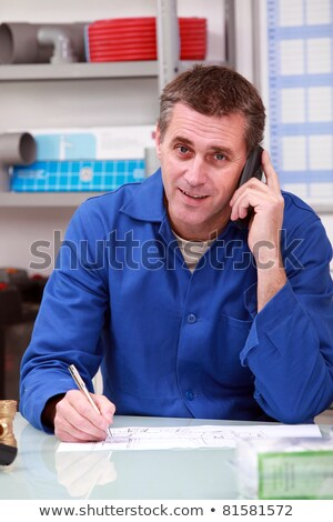 Man in a plumber's merchants taking an order on the telephone stock photo © photography33