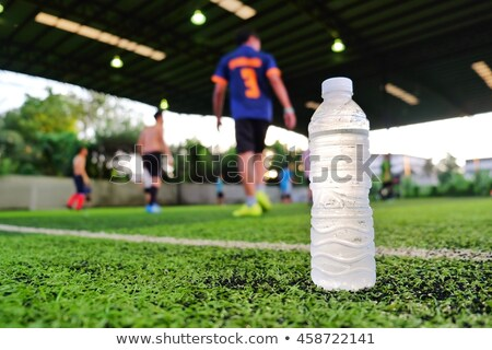 Futballista iszik energiaital futball sportok portré Stock fotó © photography33