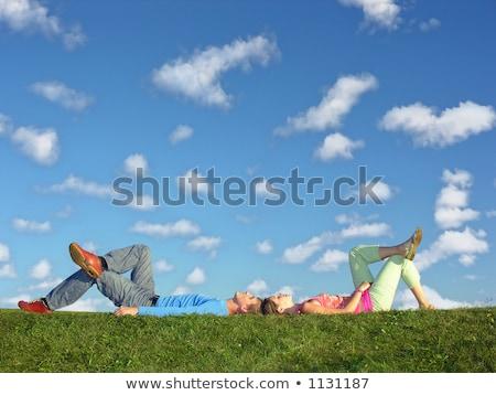 couple lies under clouds stock photo © paha_l