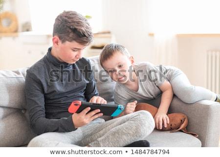 Enfants portable console de jeux ordinateur technologie amusement Photo stock © photography33