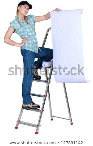 Stockfoto: Vrouwelijke · behang · huis · glimlach · werk